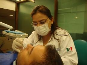 Dr. Norma Alfaro with a Patient - Cancun Cosmetic Dentistry