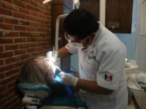 Dr. Cesar Ibanez with a Patient - Cancun Cosmetic Dentistry